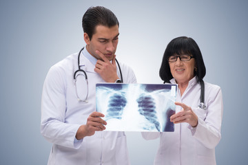 Two doctors looking at x-ray image