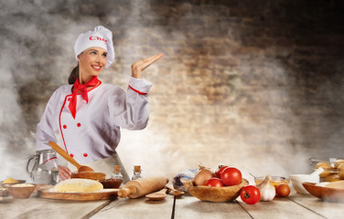 Young chef woman cooker ready for food preparation