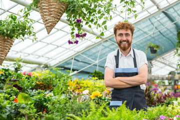 Male florist posing at his greenhouse