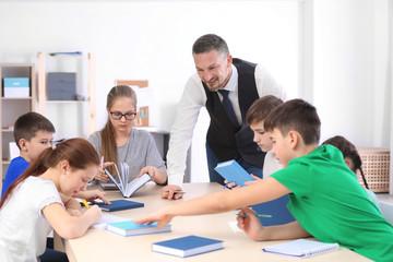 Male teacher conducting lesson in classroom