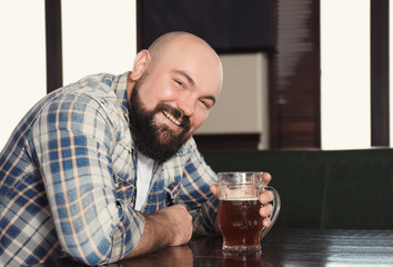 Man with glass of beer in pub