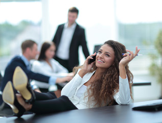 Business and office concept - smiling business woman resting at