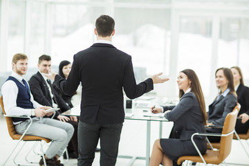 CEO speaks at the workshop business team in a modern office