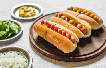 Selection of classic hot dogs against white background