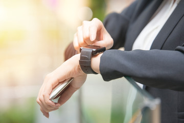 close up of woman hands setting smartwatch outside