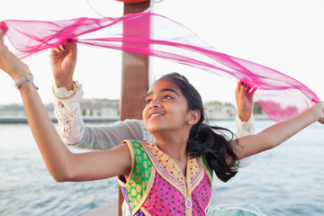 Girl enjoying on boat at Dubai Creek.