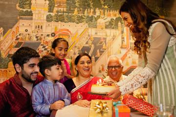 Family celebrating birthday.