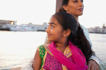 Mother and daughter traveling on boat at Dubai Creek