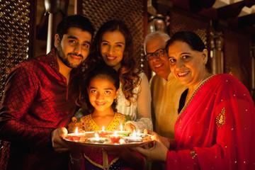 Portrait of family celebrating diwali.