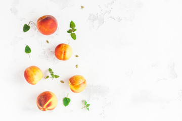 Fresh peaches on white background. Flat lay, top view, copy space