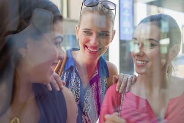 Women behind glass.