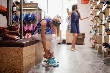 Women shopping for shoes at boutique.