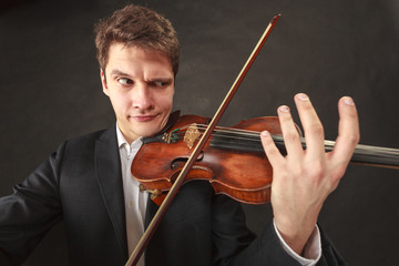 Man playing violin showing emotions and expressions