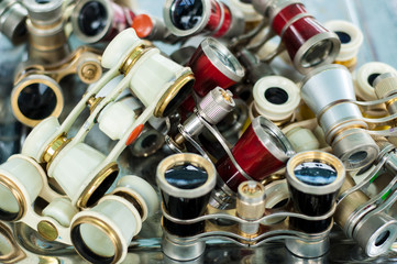 Opera glasses. small binoculars for use at the opera or theater.