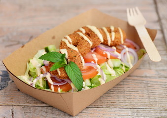 Close up of take away bowl with fast food  chicken salad