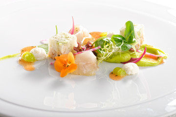 Fine dining, Elegant seabass tartare with avocado and pesto topped balsamic sauce