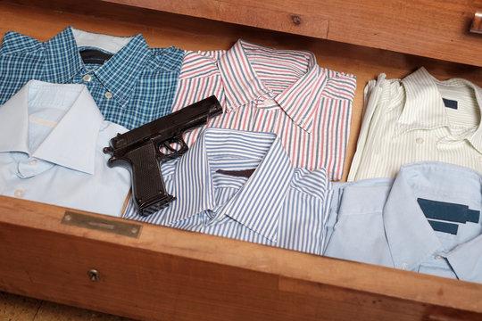 Gun hidden in  drawer full of shirt at home