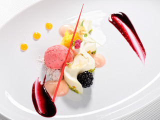 Fine dining dessert, Raspberry Parfait, ice cream, white chocolate mousse and spices