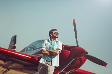 Man in front of vintage plane