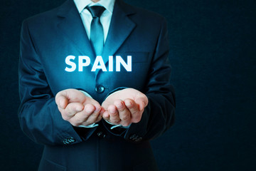 Young businessman holds a Spain word