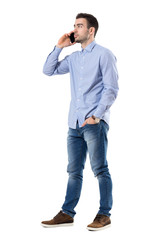 fefa61ecb6f Relaxed young smart casual business man typing message on mobile ...