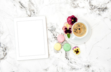 Tablet PC coffee cookies spring pansy flowers Floral flat lay