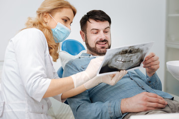 Motivated admirable dentist having some good news