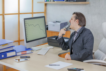 A businessman is pointing a gun at his mouth. He is frustrated.