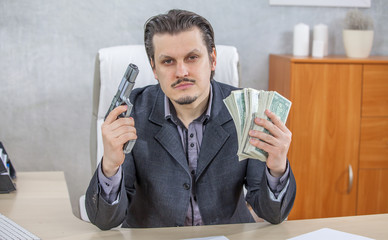 A businessman is showing money and a gun in both hands.