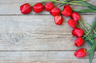 Flowers tulips on the wooden floor