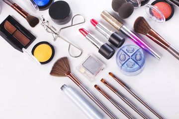 Makeup cosmetics tools and essentials, flat lay on white background