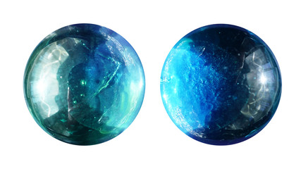 Two transparent round glass balls are close-up similar to alien planets with beautiful lighting, texture and craters.