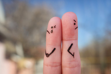Fingers art of couple. Couple after an argument looking in different directions.