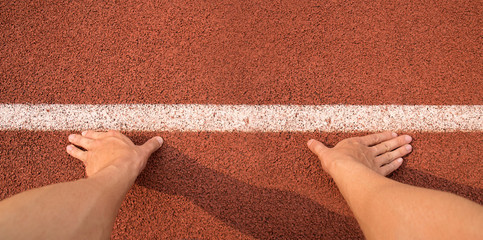 Top view Touch hands to line start for running on Athletics track