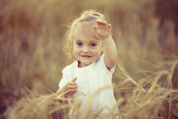 beautiful portrait of a young child in a field
