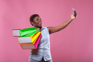 selfie African American on a pink background