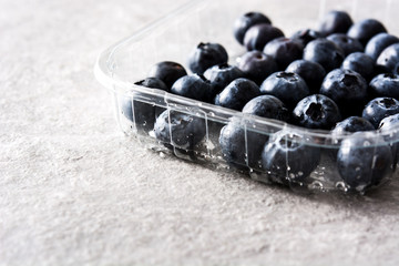 Blueberries in on gray stone