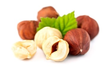 Filbert nuts with leaf .