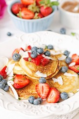 Coconut pancakes with berries