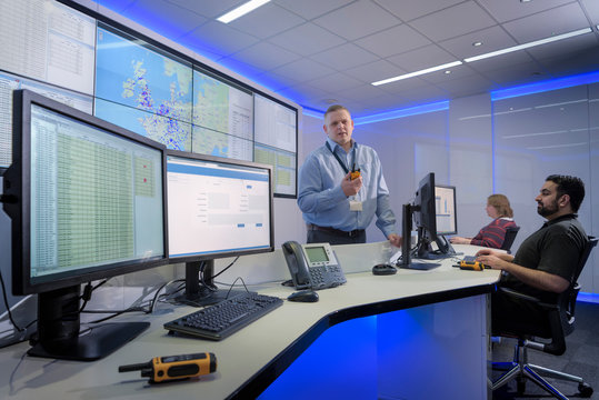 Portrait of operator in automotive emergency response control room in car factory