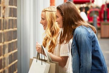 Women window shopping, London, UK