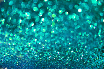 blue glitter blurred defocused texture. Christmas abstract sparkle background for party invitation...