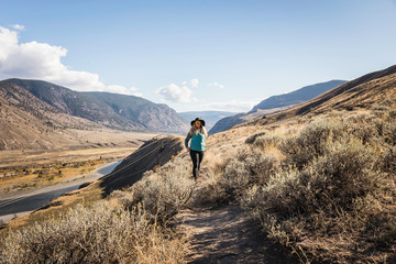Woman hiking, Trans Canada Highway, near Kamloops, Boston Flats, British Columbia, Canada