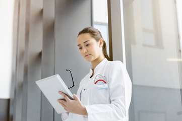 Female doctor reading papers
