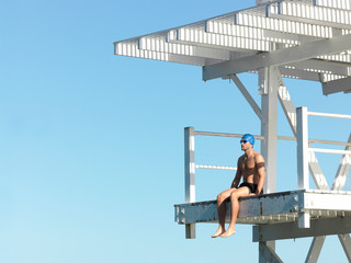 Swimmer sitting on diving board