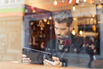 man working with laptop and smartphone