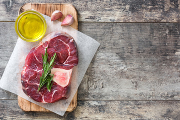 Raw meat and ingredients on wooden background