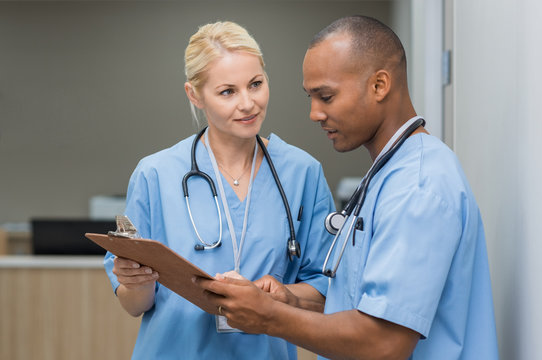 Nurses checking medical reports