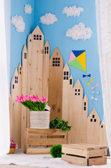 bright interior with wooden houses and kite and clouds in the child's room