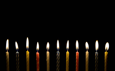 Lighting of birthday candle in the darkness
